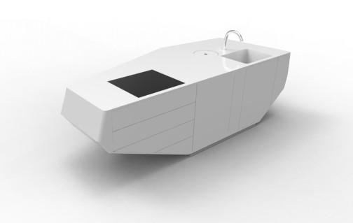 Afin d'éviter de mettre des poignées, l'îlot intègre des tiroirs à aide électrique Blum